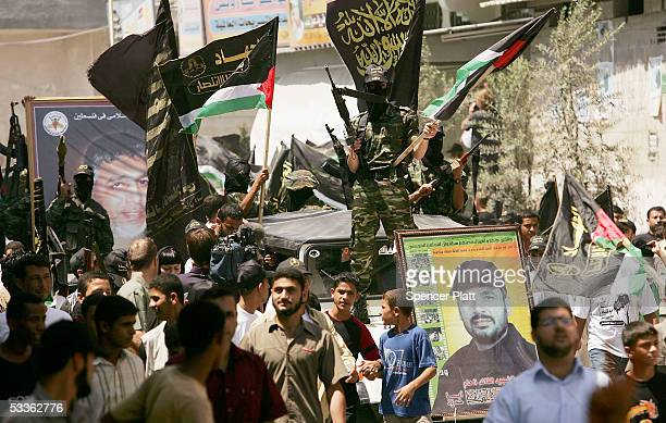 Members of the Palestinian group Islamic Jihad display weapons while walking through the streets in a march with supporters August 12 2005 Gaza City...