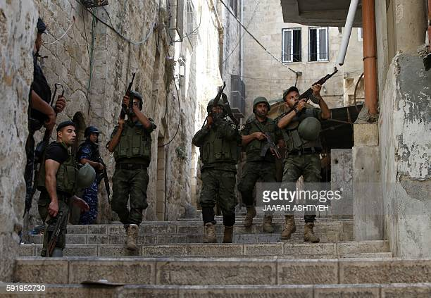 Members of the Palestinian security forces patrol in the West Bank city of Nablus on August 19,2016 during ongoing clashes between the security...