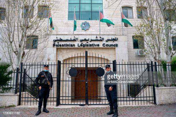 Members of the Palestinian security forces stand guard outside the Legislative Council building in the occupied-West Bank town of Ramallah, on...
