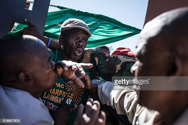 Members of the PanAfricanist Congress of Azania protest against South Africa's ruling African National Congress party at the gates of the Human...