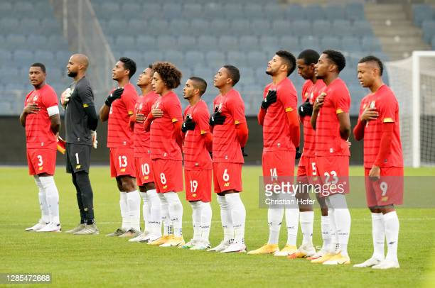 Members of the Panama team line up for the anthems prior to the international friendly match between Japan and Panama at Merkur Arena on November 13,...