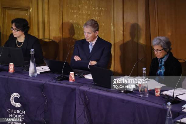 Members of the panel Ambreena Manji, Nick Vetch and Parveen Kumar listen as Chair of the panel Geoffrey Nice gives the opening address on the first...