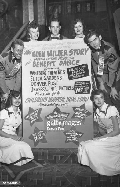 Members of the Paramount theater service staff all agog themselves at the prospect make a smiling frame around an invitation for all Denver to enjoy...