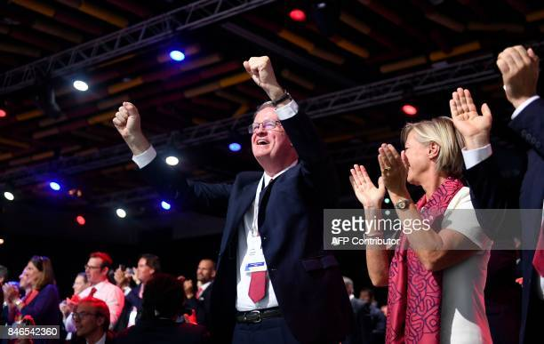 Members of the Paris 2024 bid delegation celebrate during the 131st International Olympic Committee session in Lima on September 13 2017 The ICO...
