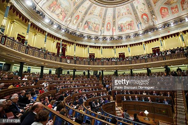 Members of the parliament listen the speech of Spanish Socialist Party leader Pedro Sanchez during a debate to form a new government at the Spanish...