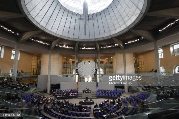 Members of the Parliament seat in the the plenary hall as Food and Agriculture Minister Julia Kloeckner speaks at the Bundestag during a first...