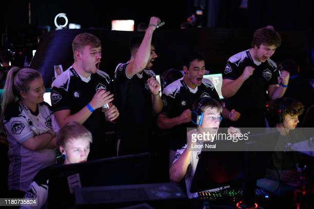 Members of the Peak eSports team cheer on their teammates as they win a round at the epicLAN esport tournament at the Kettering Conference Centre on...