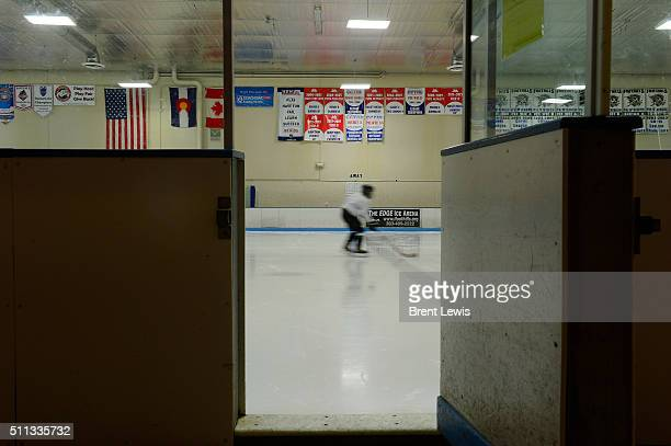 Members of the Pee Wee team skate around during warm ups for practice at Edge Ice Arena on February 17 2016 in Littleton Colorado Hockey has...