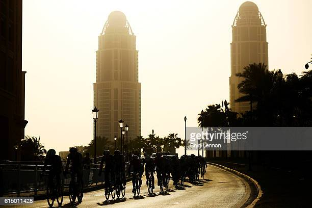 Members of the peloton ride during the Elite Men's Road Race on day eight of the UCI Road World Championships on October 16 2016 in Doha Qatar