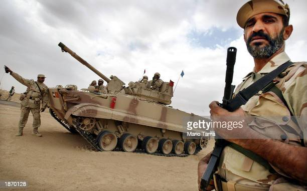 Members of the Peninsula Shield force stand guard 40 kilometers from the KuwaitIraq border March 25 2003 in Salmi Kuwait The 10000 man unit combines...
