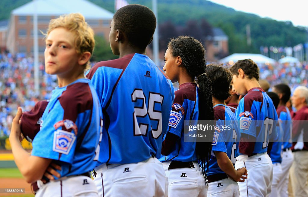 Members of the Pennsylvania team listen to the national anthem against Nevada during their 8-1 loss during the United States division game at the Little League World Series tournament at Lamade Stadium on August 20, 2014 in South Williamsport, Pennsylvania.