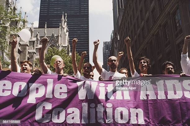 Members of the People With AIDS movement carry a banner during the Gay Pride parade in New York City USA June 1986