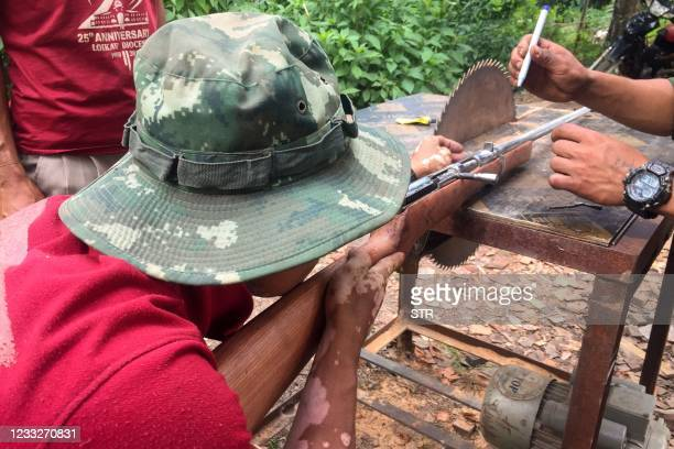 Members of the People's Defence Force make handmade guns to be used in fighting against security forces near Demoso, Kayah state on June 4 as the...
