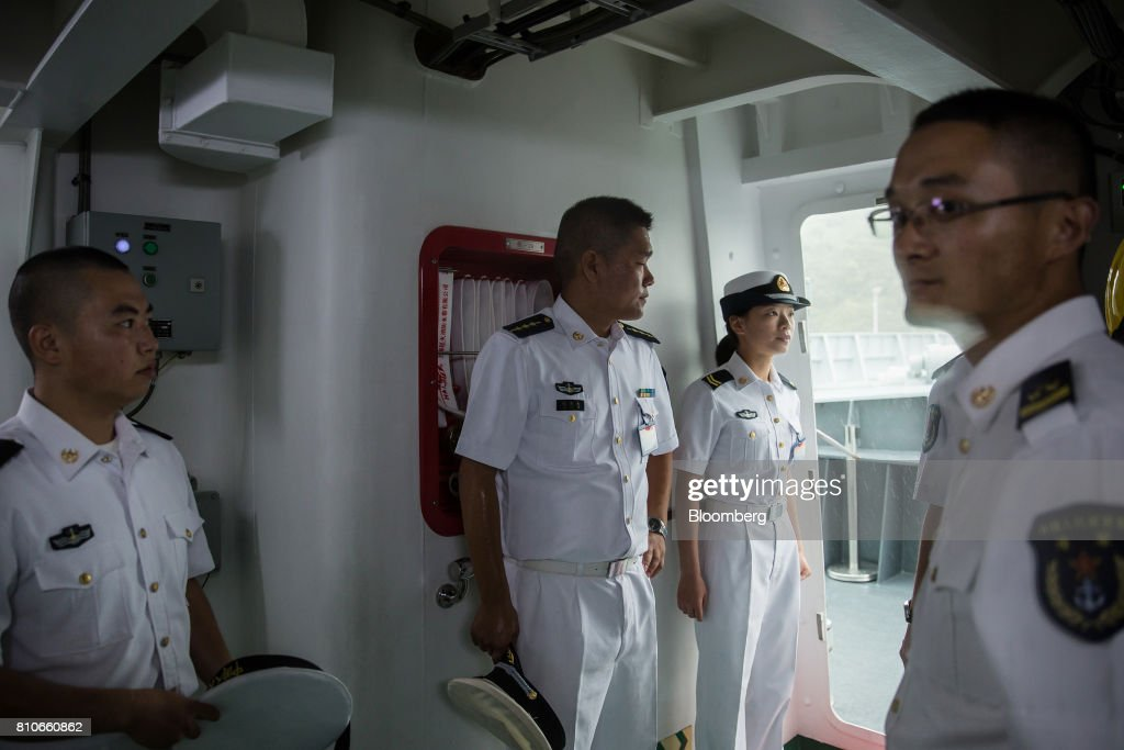 Members of the People's Liberation Army (PLA) Navy stand onbaord a ship during an open day at the Ngong Suen Chau Barracks in Hong Kong, China, on Saturday, July 8, 2017. China's bid to display some soft power in Hong Kong-- with a visit by the country's first aircraft carrier -- has also showcased its heavy-handed approach to security. Photographer: Billy H.C. Kwok/Bloomberg via Getty Images