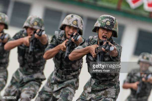 Members of the People's Liberation Army perform drills during a demonstration at an open day at the Shek Kong Barracks on June 30 2018 in Hong Kong...