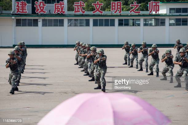 Members of the People's Liberation Army perform during a demonstration at an open day at the San Wai Barracks in Hong Kong China on Saturday June 29...