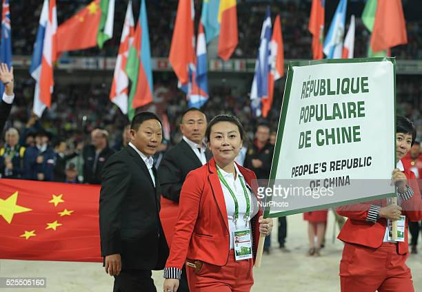 Members of the People's Republic of China Team during the Parade of Nations at the Opening Ceremony of the ALLTECH FEI WORLD EQUESTRIAN GAMES 2014 at...