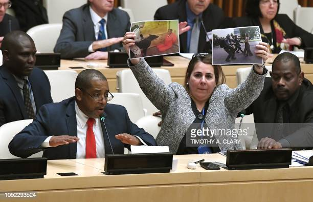 Members of the Permanent Mission of Cuba to the United Nations protest during a meeting at the United Nations October 16 2018 on the launch of the...