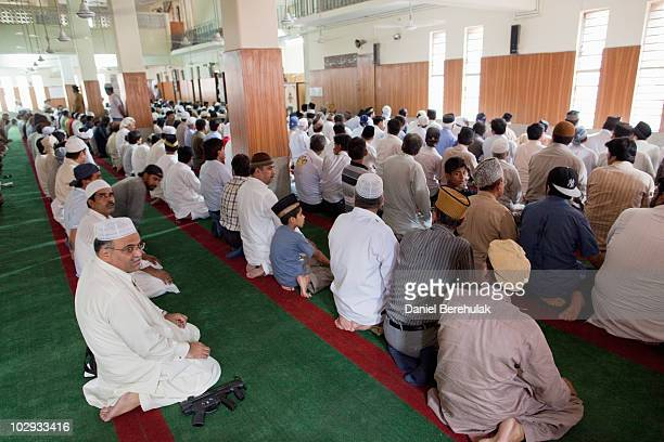 Members of the persecuted Ahmadiyya community attend Friday prayers at the Garhi Shahu mosque on July 16 2010 in Lahore Pakistan The Pakistani...