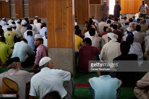 Members of the persecuted Ahmadiyya community listen to the sermon during Friday prayers at the Garhi Shahu mosque on July 16 2010 in Lahore Pakistan...