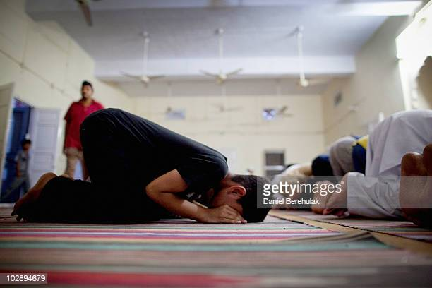 Members of the persecuted Ahmadiyya community pray in a mosque on July 14 2010 in Chenab Nagar Pakistan The Pakistani Ahmadis define themselves as...