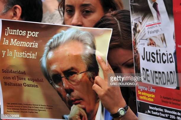 Members of the Peruvian Lawyers Bar and Human Rights activists stage a rally in front of the consulate of Spain in Lima on May 21 in support of...
