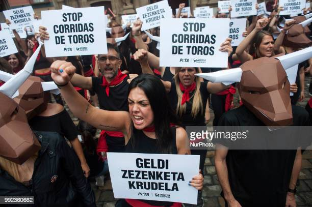Members of the PETA collective carry banners with the slogan quotStop bullfightingquot during their protest in the town hall of Pamplona for the...