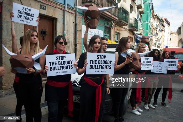 Members of the PETA collective carry signs with the slogan quotStop bullfightingquot during their protest in the Plaza del Ayuntamiento in Pamplona...