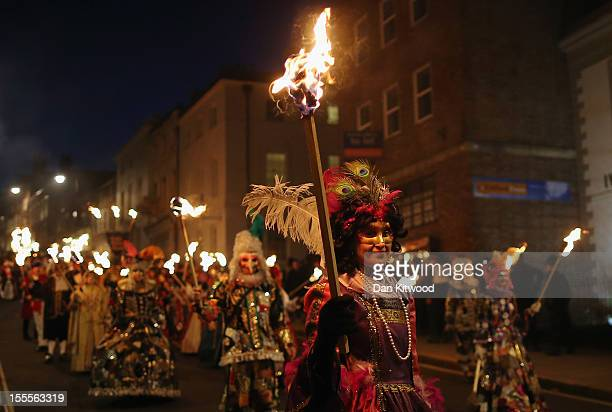 Members of the Pheonix Bonfre society walk with burning staffs during the Bonfire Night celebrations on November 5 2012 in Lewes Sussex in England...