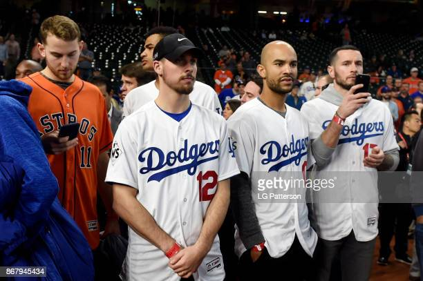 Members of the Philadelphia 76ers are seen on the field during batting practice prior to Game 5 of the 2017 World Series between the Los Angeles...
