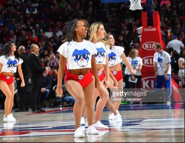 Members of the Philadelphia 76ers dance team look on against the Boston Celtics at Wells Fargo Center on March 19 2017 in Philadelphia Pennsylvania...