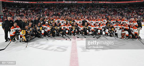 Members of the Philadelphia Flyers Alumni and the Pittsburgh Penguins Alumni pose for a photo following their game on January 14 2017 at the Wells...