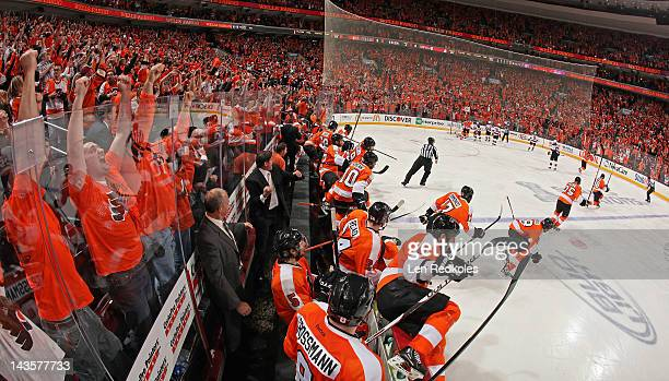 Members of the Philadelphia Flyers celebrate after Danny Briere scored the gamewinning goal in overtime against the New Jersey Devils in Game One of...