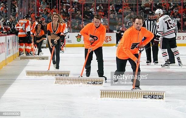 Members of the Philadelphia Flyers crew clean the ice during a timeout against the Chicago Blackhawks on October 14 2015 at the Wells Fargo Center in...