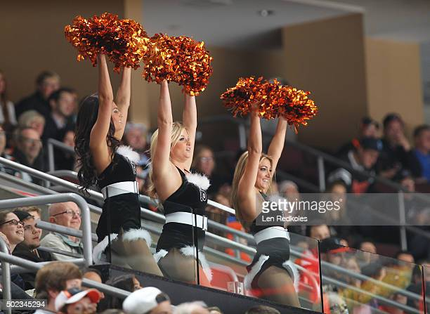 Members of the Philadelphia Flyers ice girls cheer on the crowd during a timeout against the Vancouver Canucks on December 17 2015 at the Wells Fargo...