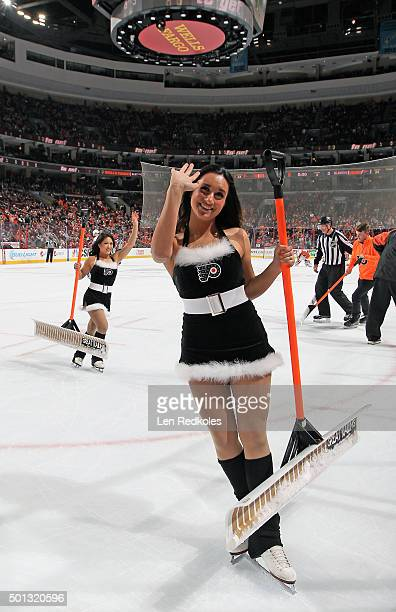 Members of the Philadelphia Flyers ice girls wave to the crowd as they skate off the ice during a timeout against the New York Islanders on December...