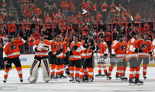 Members of the Philadelphia Flyers salute their fans after being defeated 10 by the Washington Capitals in Game Six of the Eastern Conference First...