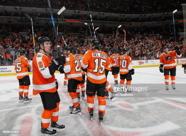 Members of the Philadelphia Flyers salute their fans in their final game of the 201617 NHL season after being defeated by the Carolina Hurricanes 43...