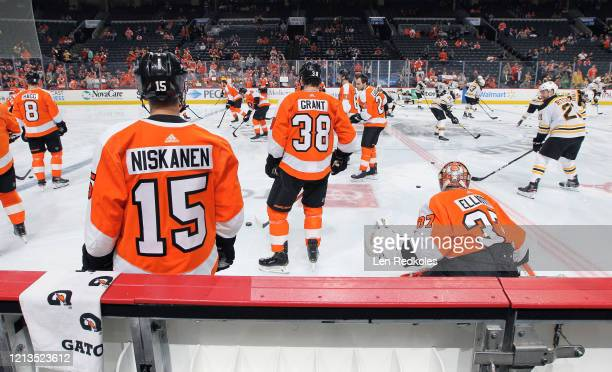 Members of the Philadelphia Flyers warm up against the Boston Bruins on March 10 2020 at the Wells Fargo Center in Philadelphia Pennsylvania