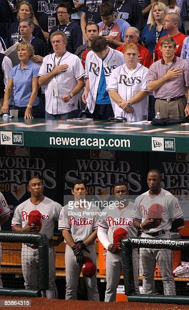 Members of the Philadelphia Phillies stand for the playing of the National Anthem along with fans of the Tampa Bay Rays during game one of the 2008...