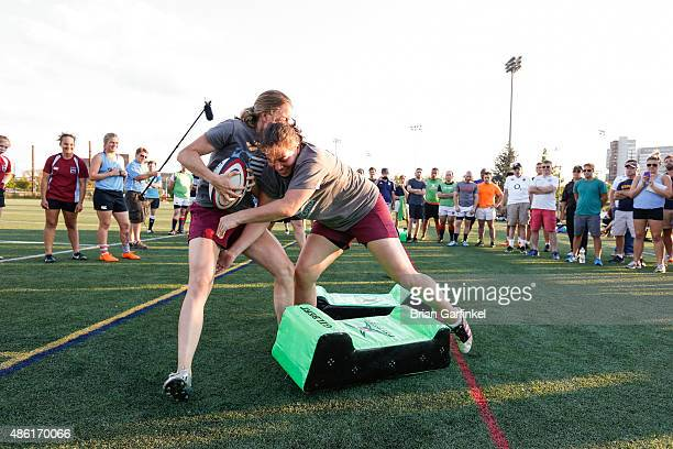 Members of the Philadelphia Women's Rugby Club participate in a demonstration during the Harlequins Coach Education Session at Adams Field in Penn...
