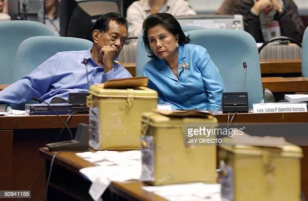 Members of the Philippine opposition Senator Aquilino Pimentel and former first lady and Senator Luisa Estrada confer in Congress in Manila 09 June...
