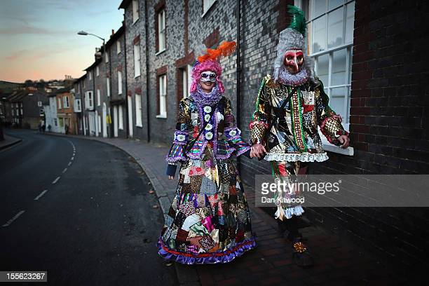 Members of the phoenix Bonfire Society walk to join a procession ahead of the Bonfire Night celebrations on November 5 2012 in Lewes Sussex in...