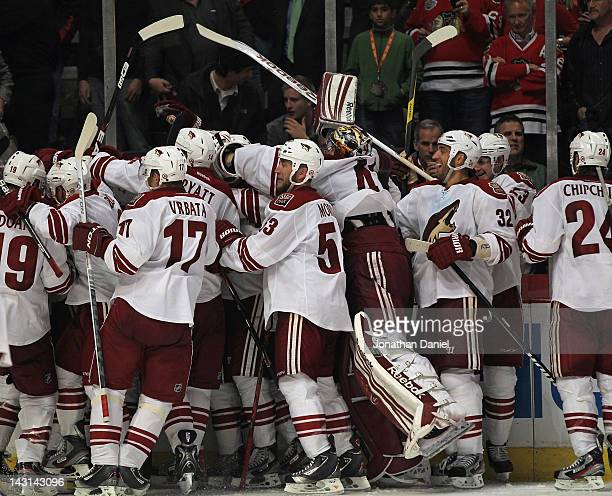 Members of the Phoenix Coyotes celebrate an overtime win against the Chicago Blackhawks in Game Four of the Western Conference Quarterfinals during...