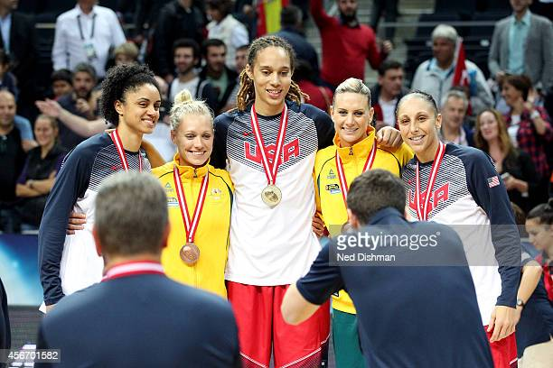 Members of the Phoenix Mercury from the Women's Senior US National Team and Australian team take a photo after receiving their medal during the...