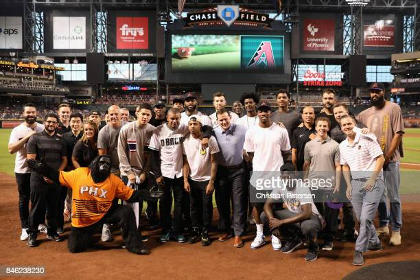 Members of the Phoenix Suns pose together on the field before the MLB game between the Arizona Diamondbacks and the Colorado Rockies at Chase Field...
