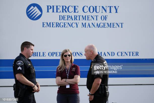 Members of the Pierce County Sheriffs Department are pictured near the Steilacoom Ferry dock which takes investigators to Ketron Island the crash...