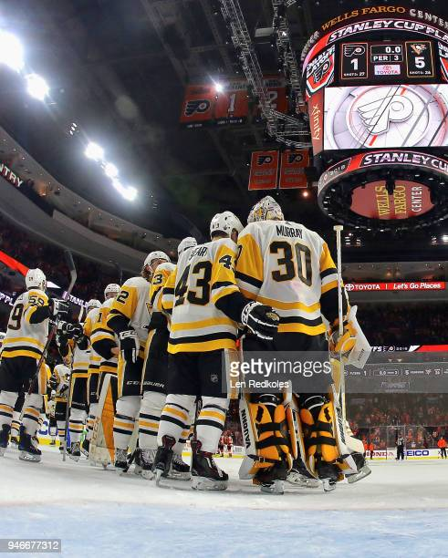 Members of the Pittsburgh Penguins celebrate after defeating the Philadelphia Flyers 51 in Game Three of the Eastern Conference First Round during...