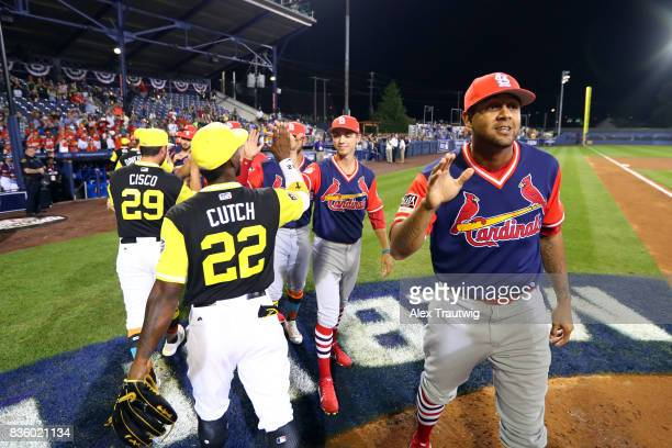 Members of the Pittsburgh Pirates and the St Louis Cardinals shake hands after the 2017 Little League Classic Game at Historic Bowman Field on Sunday...