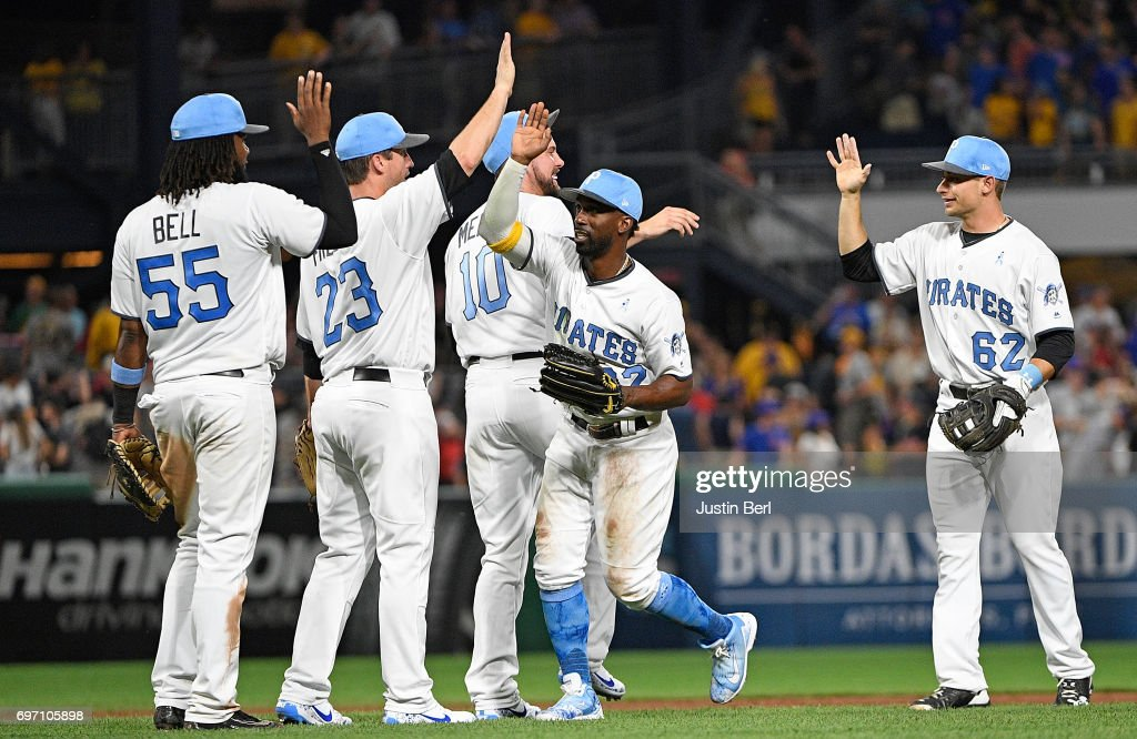 Members of the Pittsburgh Pirates celebrate after the final out in their 4-3 win over the Chicago Cubs at PNC Park on June 17, 2017 in Pittsburgh, Pennsylvania.